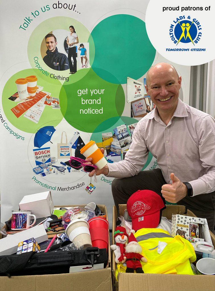 Pete Slater, director of Silk Group, with the boxes of goodies for Bolton Lads and Girls Club